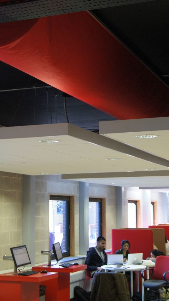 red ventilation duct in university ceiling