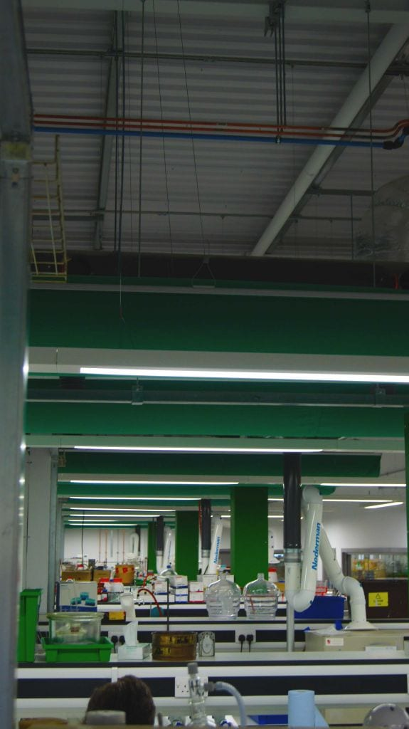 multiple green fabric ducts across length of laboratory area at university of york
