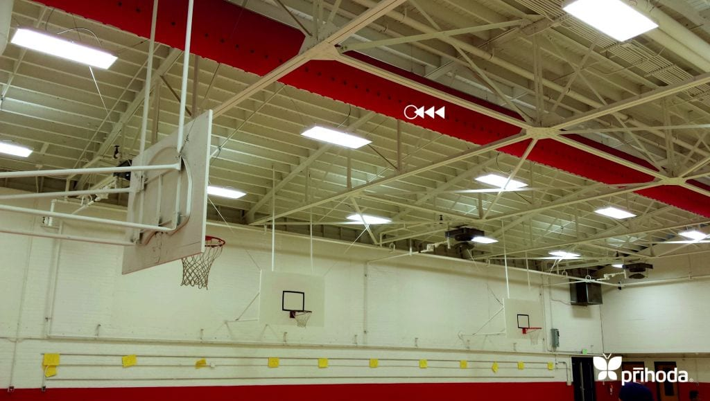 sports arena with basketball hoop