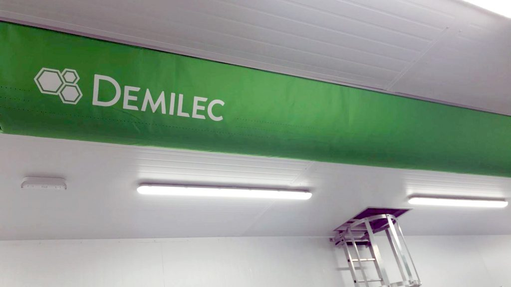 Custom green ventilation duct with printed logo.