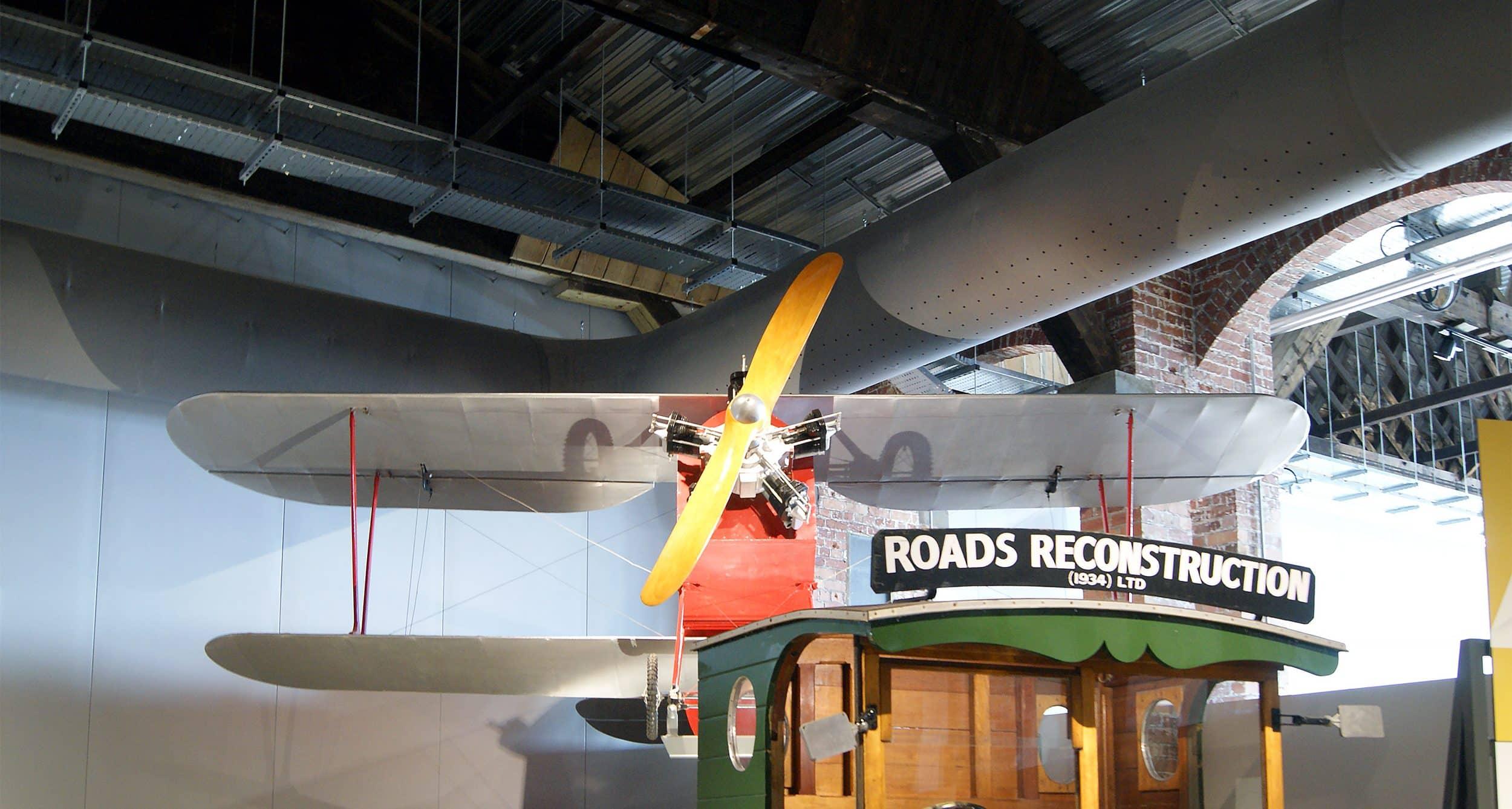 A grey fabric diffuser shown behind an aeroplane model at Aerospace Bristol