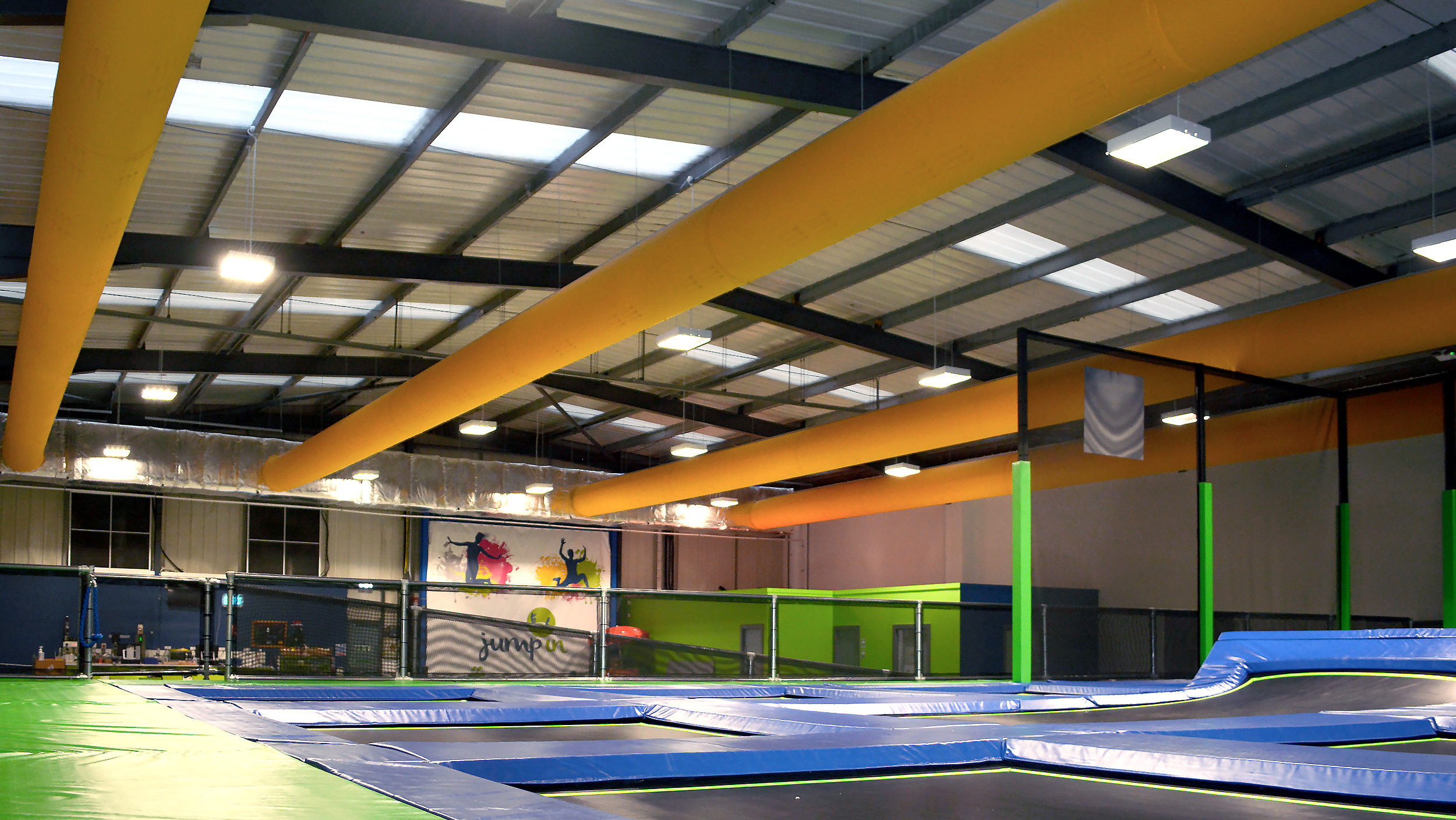 An indoor trampoline park with Prihoda fabric ducts.